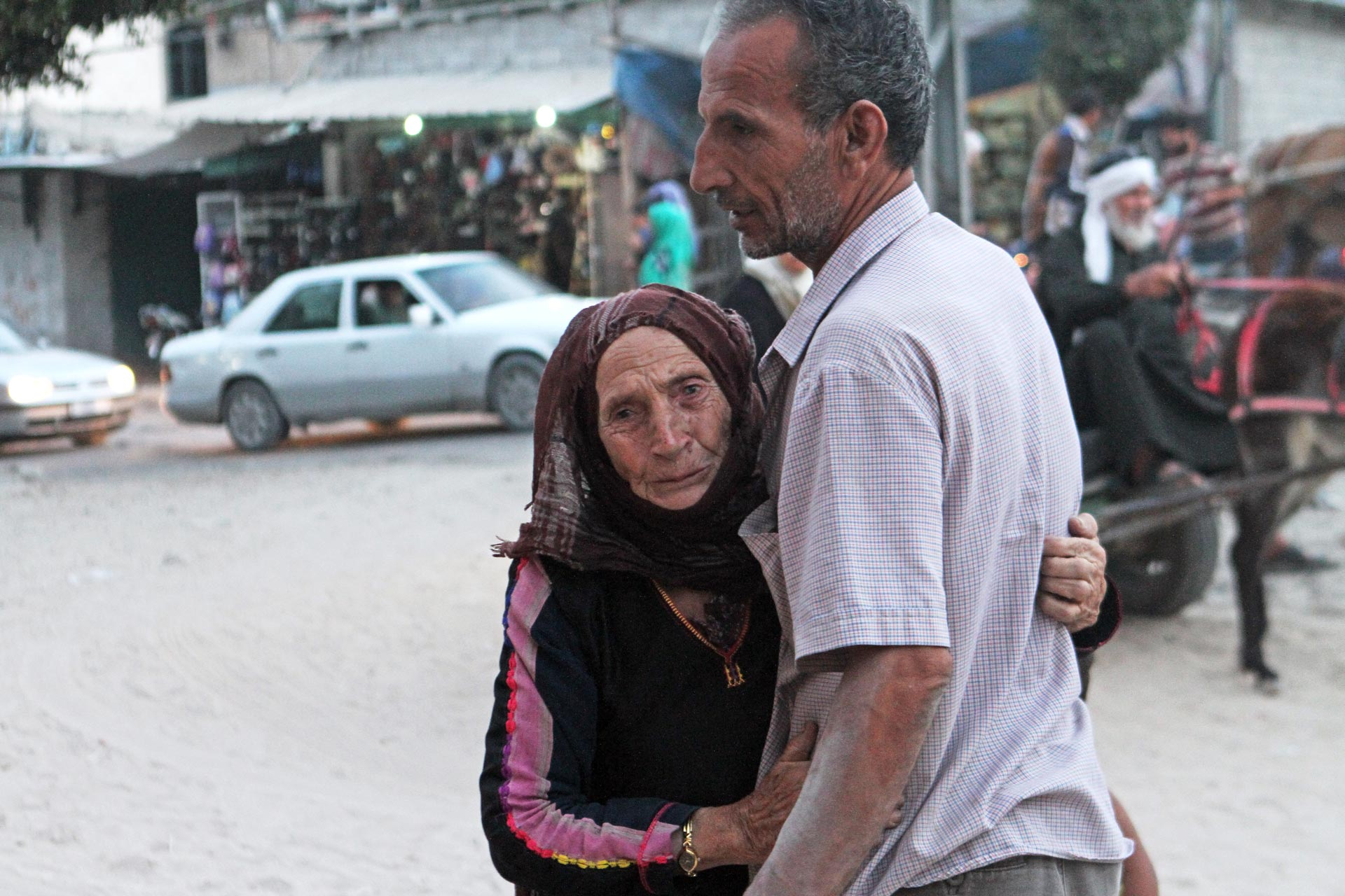 Fatma al-Kilani, always searching or waiting for her son Ibrahim to return home. Here, she embraces her eldest, Saleh.