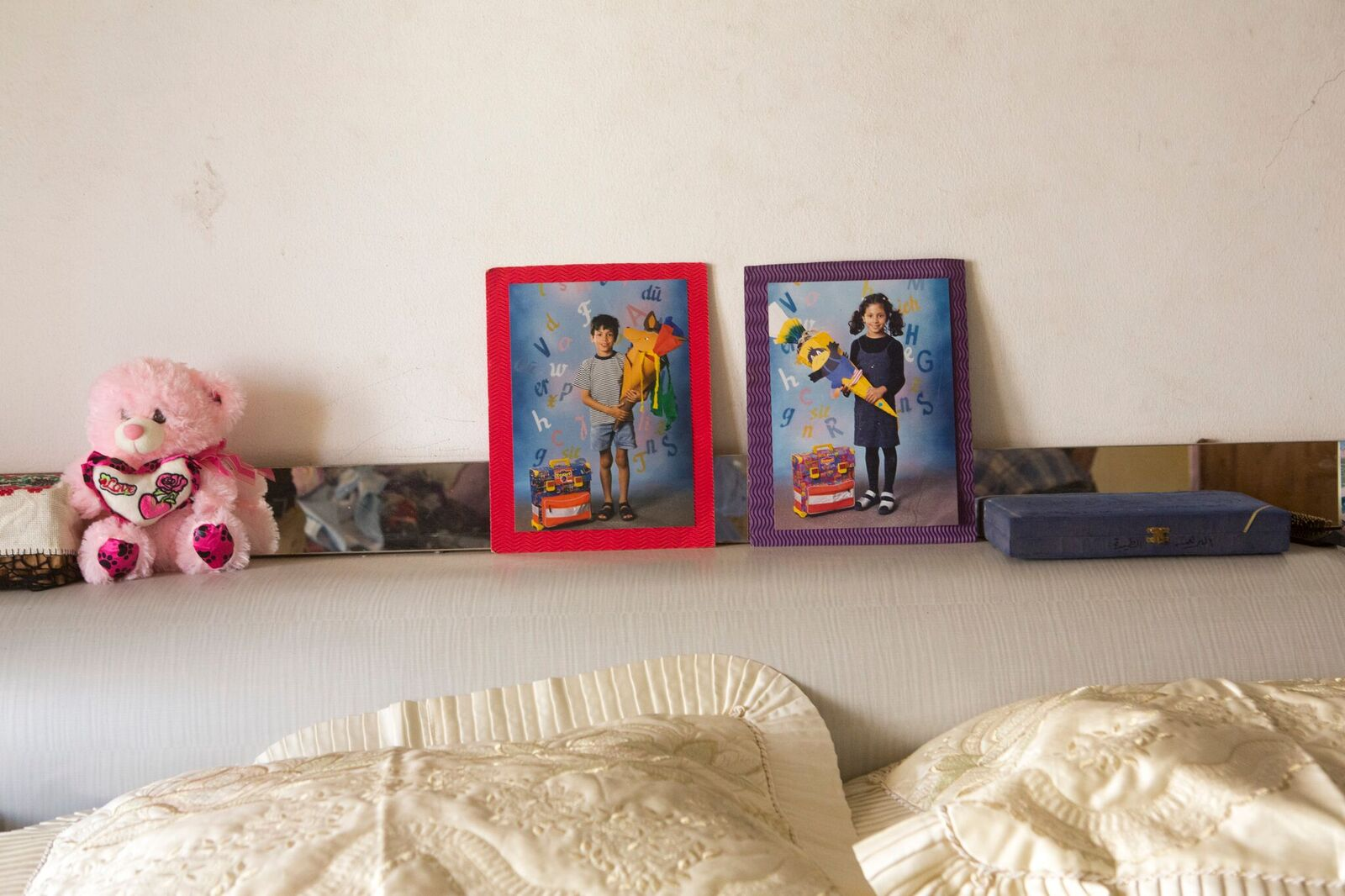 After returning to Gaza, Ibrahim married Taghrid. They had five children. Still, he missed Ramsis and Layla. Their childhood photos took the honorary spot above the bedhead in Kilani's house.