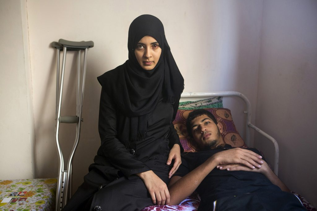 Oifa and Momem Alouh, the only daughter and son remaining of Mustafa Alouh, is seen injured following an Israeli airtrike during the last Israeli offensive, in Deir al-Balah city, September 16, 2014. The attack killed 8 members of his family- Ahmad, 22 and Mohammaed, 22 (sons of Mustafa) Rafat, 32 (son of Mustafa) ) and his wife Nabila and their three children Mustafa (10), Maisara (7) and Farah (6), as well as Eman, 18 (Mustafa' niece). Mustafa survived as he woke up for pray and went to the kitchen. Mustafa has two children left Oifa and Momem, both injured during the attack. During the seven-week Israeli military offensive, 2,131 Palestinians were killed, including 501 children, and an estimated 18,000 housing units have been either destroyed or severely damaged, leaving more than 108,000 people homeless.