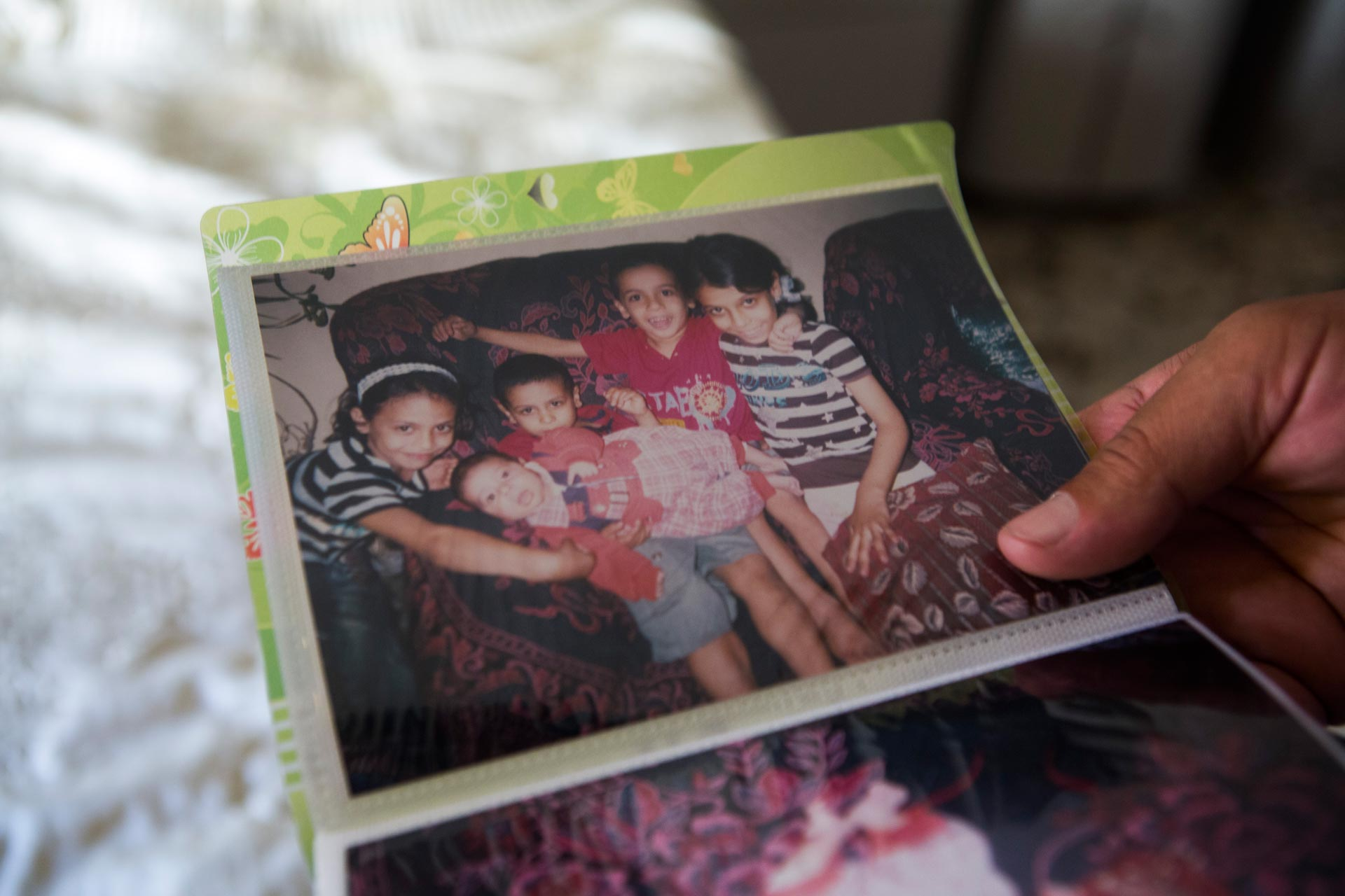 They had five little kids: Yassin, Sawsan, Rim, Elias and Yasser.